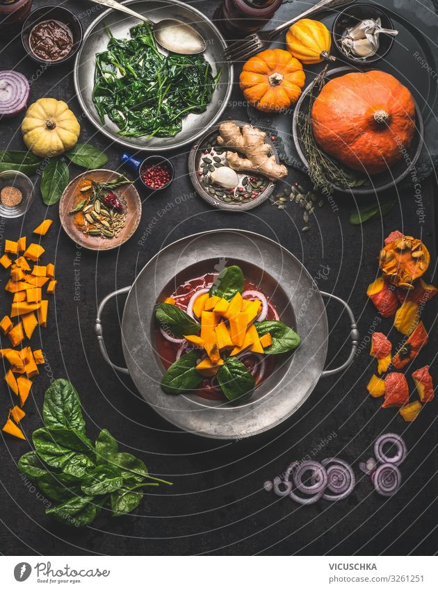 Cooking of seasonal vegetarian meals for autumn and winter Winter Erntedankfest Essen cooking pumpkin spinach ginger onion top view healthy food concept above