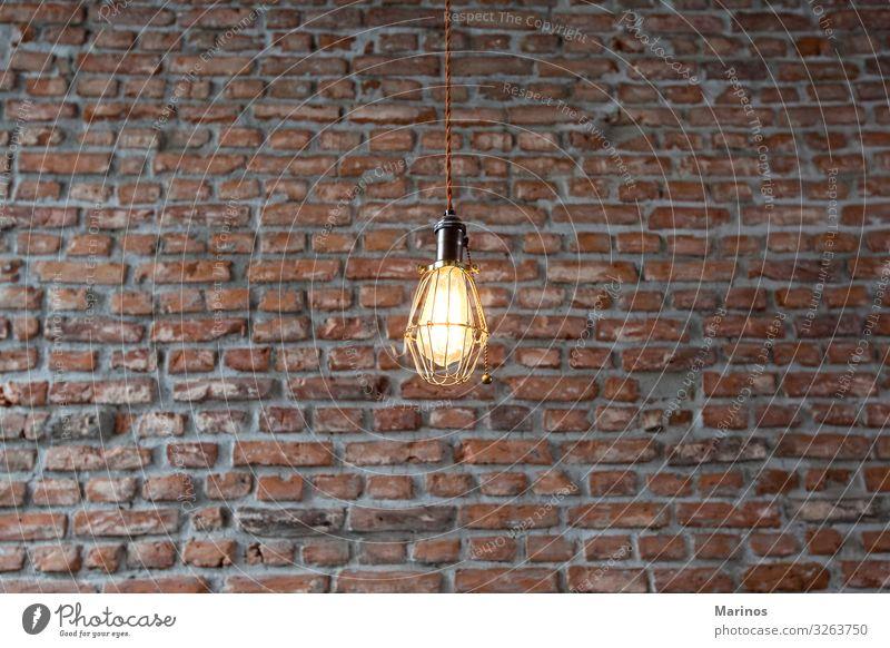Leuchten an einer Wand mit Backsteinhintergrund. kaufen Reichtum Design Innenarchitektur Dekoration & Verzierung Lampe Industrieanlage Gebäude Architektur Licht