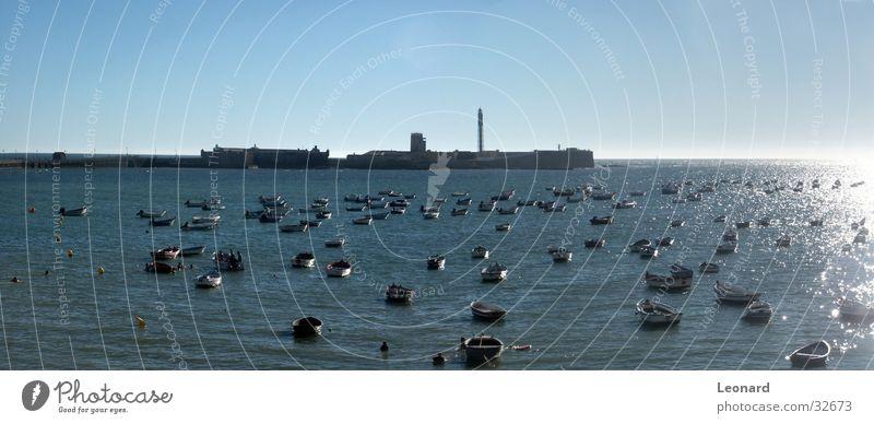 Cadiz Meer Atlantik Wasserfahrzeug Leuchtturm Andalusien Spanien Reflexion & Spiegelung Bucht Burg oder Schloss Sonne Himmel