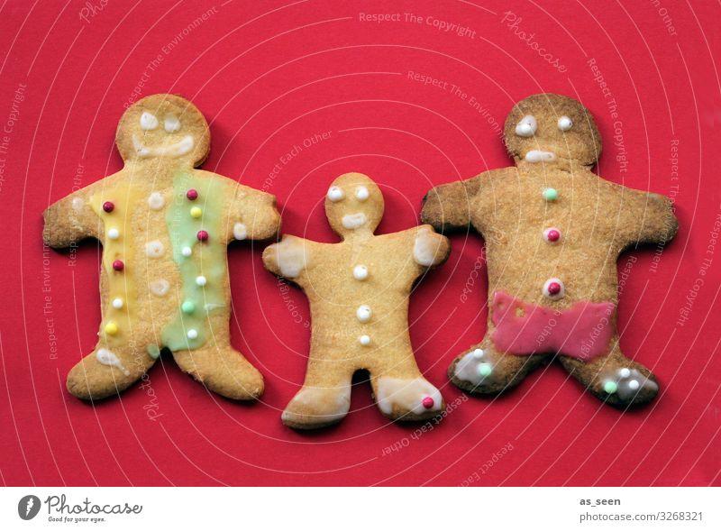 Vater Mutter Kind Lebensmittel Teigwaren Backwaren Kuchen Süßwaren Lebkuchen Keks Ernährung Weihnachten & Advent Kindheit festhalten frech Zusammensein