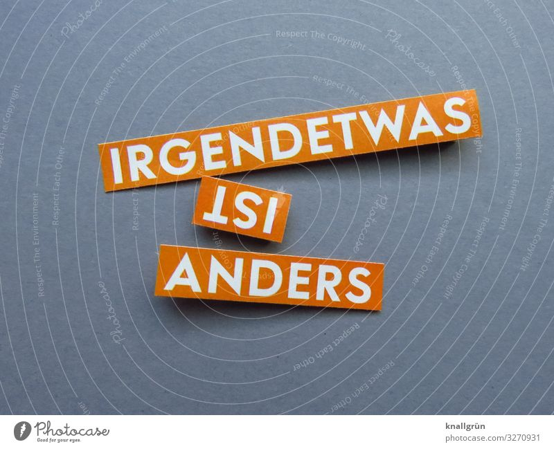 IRGENDETWAS IST ANDERS Schriftzeichen Schilder & Markierungen Kommunizieren grau orange weiß Gefühle Neugier Erwartung Stimmung Irritation irgendetwas