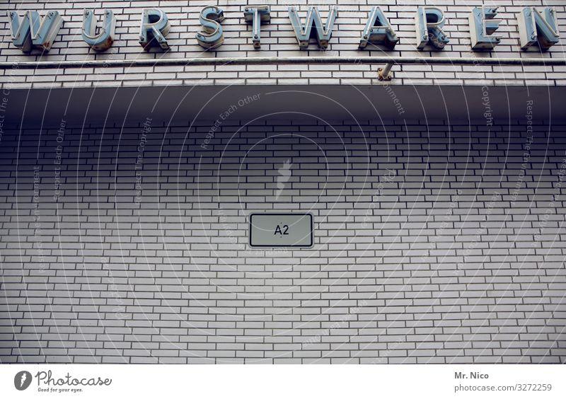 Woosch un Wööschje Lebensmittel Fleisch Wurstwaren Ernährung Haus Mauer Wand Fassade trist grau Metzgerei Handel Partyservice Schriftzeichen Ladengeschäft Ware