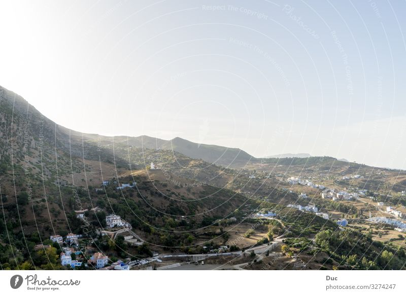 View over Chefchaouen Sommer Strand Natur Riff Stimmung landscape mountain water sky hill Großstadt valley fog architecture tree Island sea house horizontal