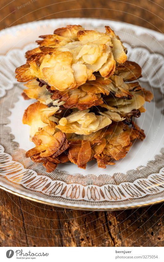 Florentiner Kekse auf einem Teller Frucht Kuchen Dessert Schokolade Reichtum elegant Weihnachten & Advent Holz dunkel einfach lecker braun Tradition florentiner