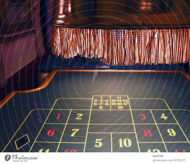 Glück oder Pech Glücksspiel braun gelb grün rot schwarz weiß verloren Risiko Einsatz Spannung Geld Roulette Beleuchtung Lampenschirm Franse ruiniert Spielkasino