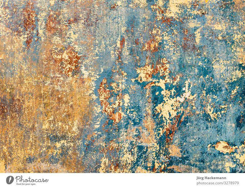 alte Grungewand eines alten Hauses mit Resten von Farbe Tapete Stein dreckig retro stark Antiquität Hintergrund Baustein Zement abgeplatzt rau Riss grung