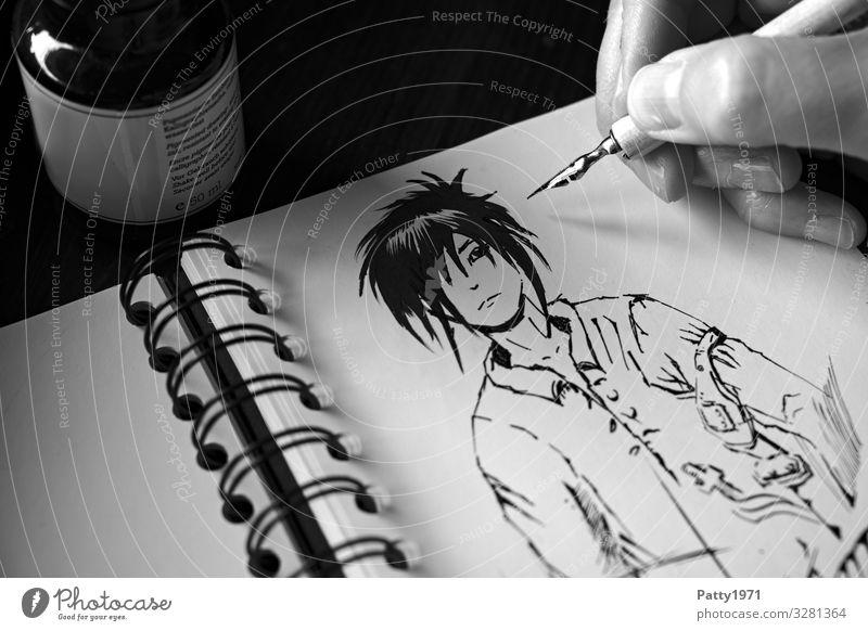 Detailaufnahme einer Hand, die mit einer Zeichenfeder eine Mangafigur in ein Skizzenbuch zeichnet 1 Mensch Kunst Künstler Maler Zeichnung Comicfigur Tusche