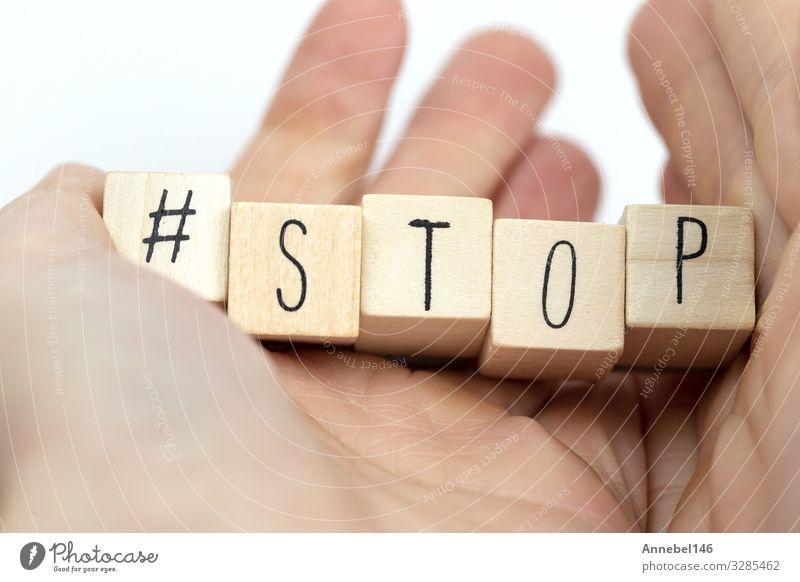 """Holzwürfel von Menschenhand mit dem Wort """"Stop"""" als Hashtag Leben Erfolg Business Hand Finger Medien Beratung Denken machen Beginn Glaube Religion & Glaube Idee"""