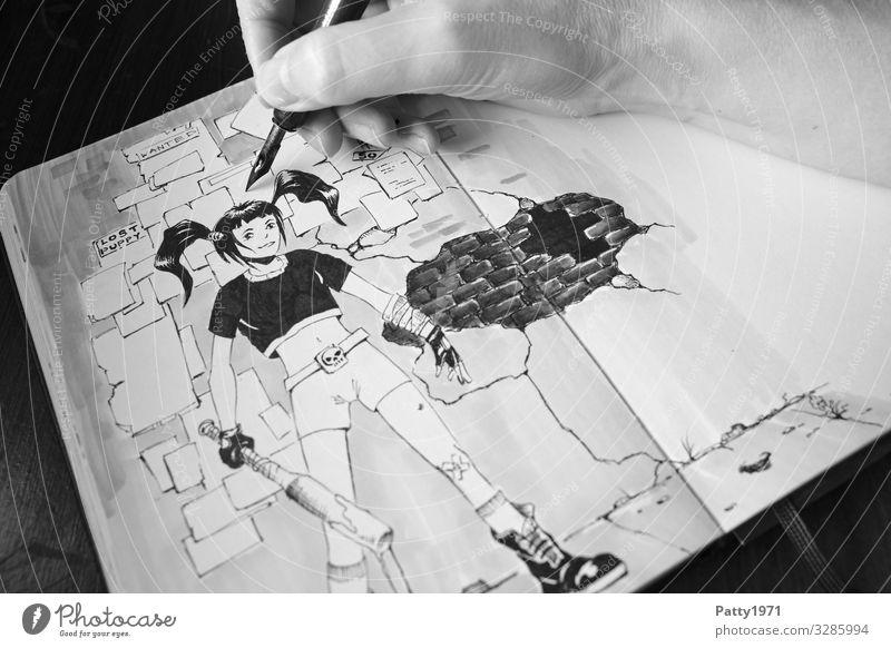 Detailaufnahme einer Hand, die mit einer Zeichenfeder eine Mangafigur in ein Skizzenbuch zeichnet Kunst Künstler Maler Kunstwerk Jugendkultur Zeichnung Comic