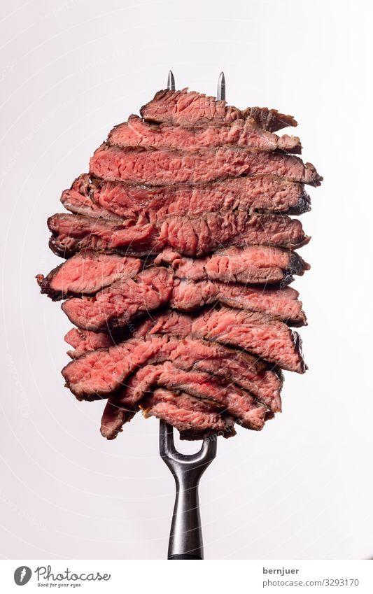 Steakscheiben Fleisch Abendessen Gabel Medien Stein dunkel dünn saftig rot schwarz weiß Qualität Metzger Barbecue Rippe Auge Steak Fett grillen selten