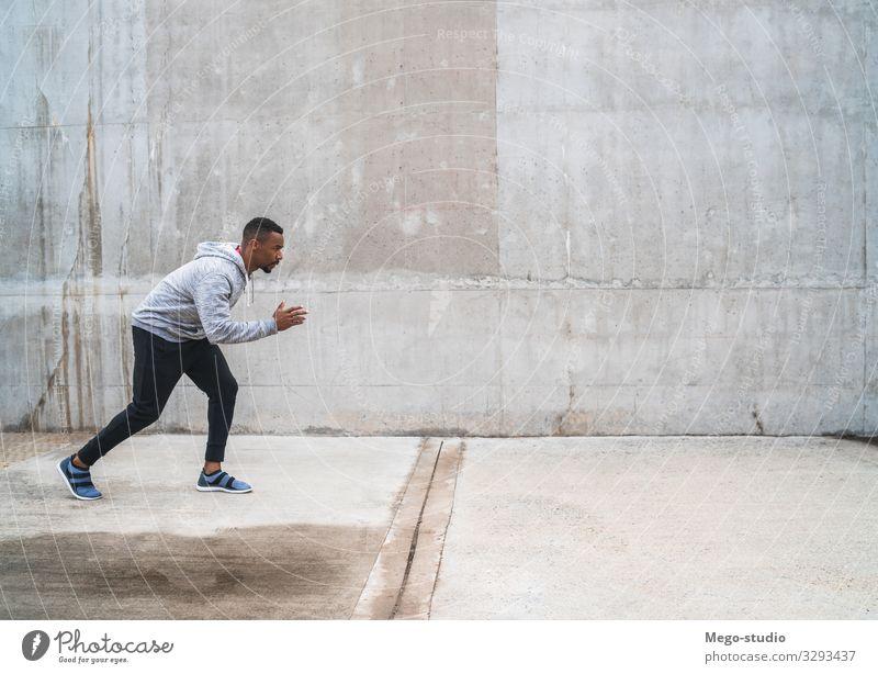 Porträt eines sportlichen Laufkünstlers. Lifestyle Körperpflege Erholung Freizeit & Hobby Sport Joggen Mensch Mann Erwachsene Fitness genießen Tatkraft Energie