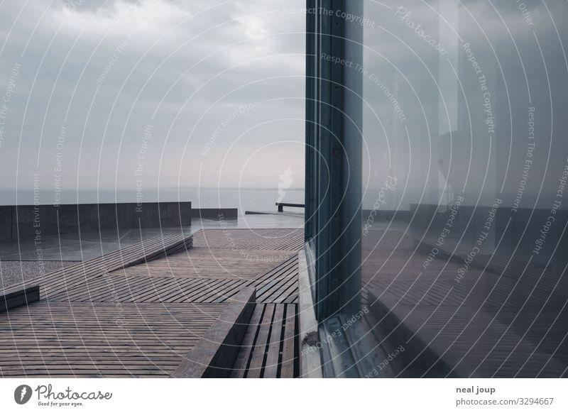 Reflecting the Grey Ferien & Urlaub & Reisen Natur Meer Einsamkeit ruhig Strand Fenster dunkel Holz Wand Küste Mauer grau Regen Horizont Glas