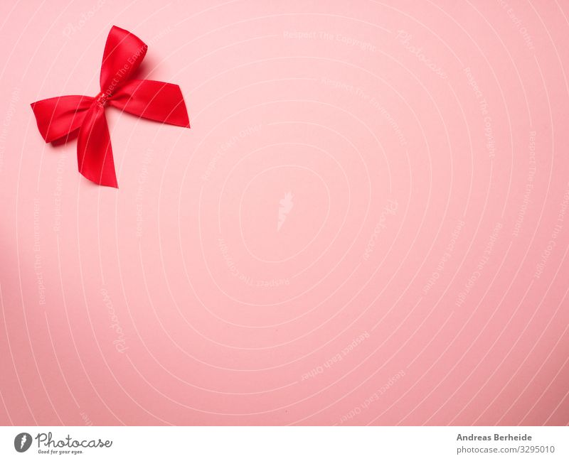 Rote Schleife auf rosa Hintergrund Stil Valentinstag Geburtstag Dekoration & Verzierung Liebe bow surprise ribbon birthday above abstract anniversary