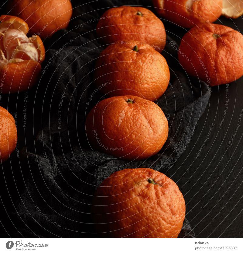 orange-reife Mandarine Frucht Dessert Vegetarische Ernährung Saft Tisch Holz frisch natürlich saftig gelb schwarz Zitrusfrüchte Lebensmittel Hälfte Ernte