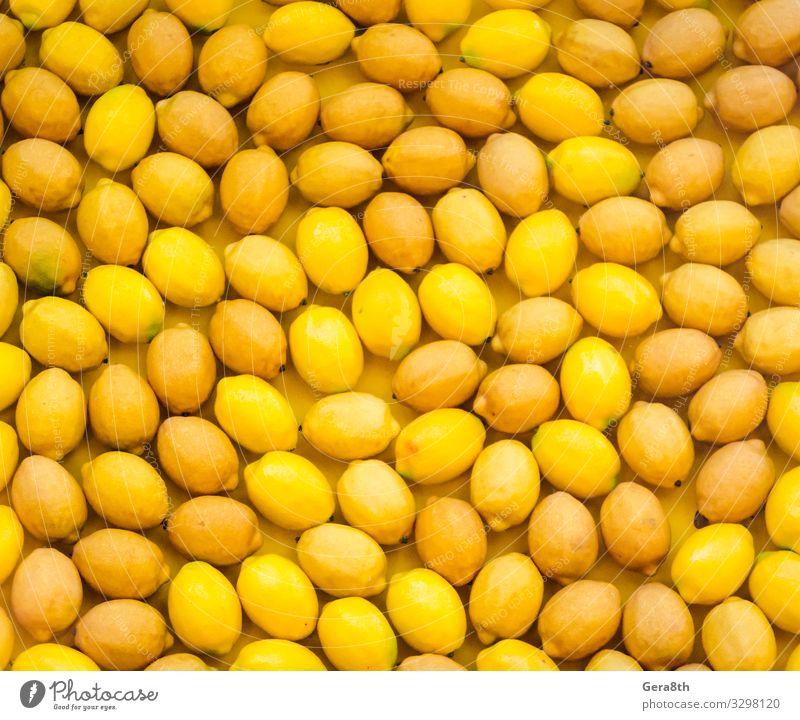 Fruchtmuster reife gelbe Zitronen natürlich saftig Hintergrund Zitrusfrüchte Lebensmittel Ernte Gesundheit zitronenfarbener Hintergrund Zitronenmuster viele