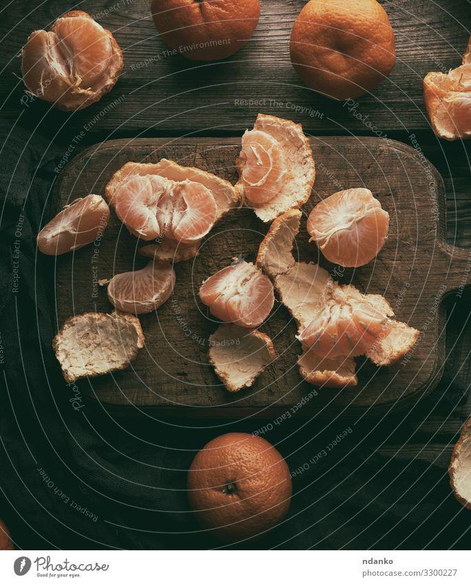 reife runde Mandarinen Frucht Ernährung Vegetarische Ernährung Saft Tisch Natur Holz frisch lecker natürlich saftig braun kreisen Zitrusfrüchte geschnitten
