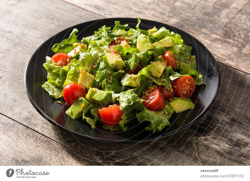 Salat mit Avocado, Kopfsalat, Tomaten und Leinsamen Kirsche Entzug Diät Lebensmittel Gesunde Ernährung Foodfotografie frisch Feinschmecker grün Gesundheit