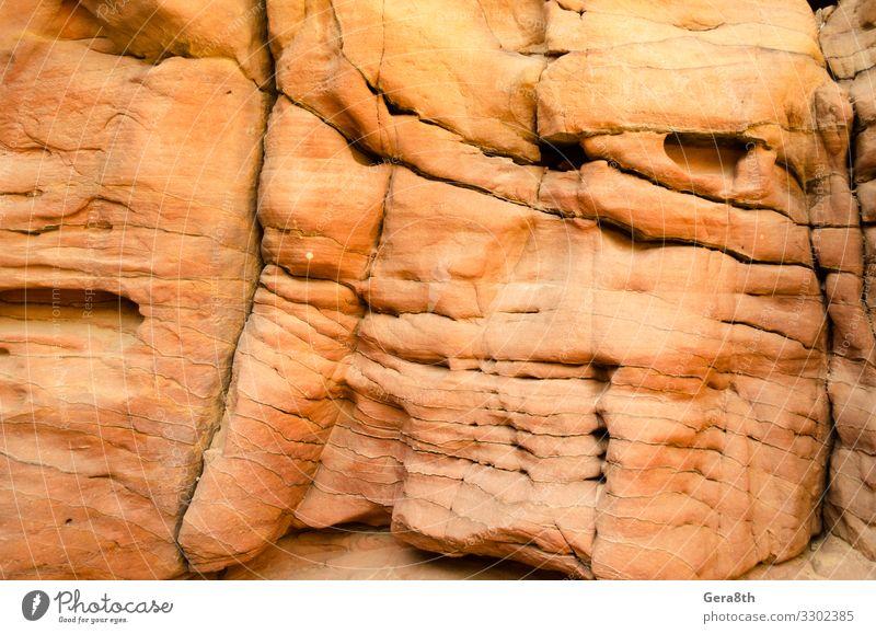 Textur eines orangefarbenen Steinfelsens in einer farbigen Schlucht aus nächster Nähe Berge u. Gebirge Natur Felsen hell Farbe Hintergrund blanko detailliert