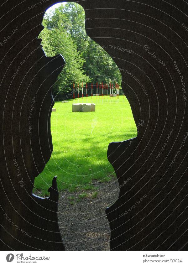 Neanderthaler 2 Mensch Sonne grün Wiese Park Kunst Kunstwerk Profil Vorfahren Projektion