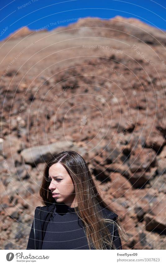 Porträt einer Frau auf dem Teide-Top Lifestyle Gesicht Ferien & Urlaub & Reisen Abenteuer Freiheit Berge u. Gebirge wandern Mensch feminin Junge Frau