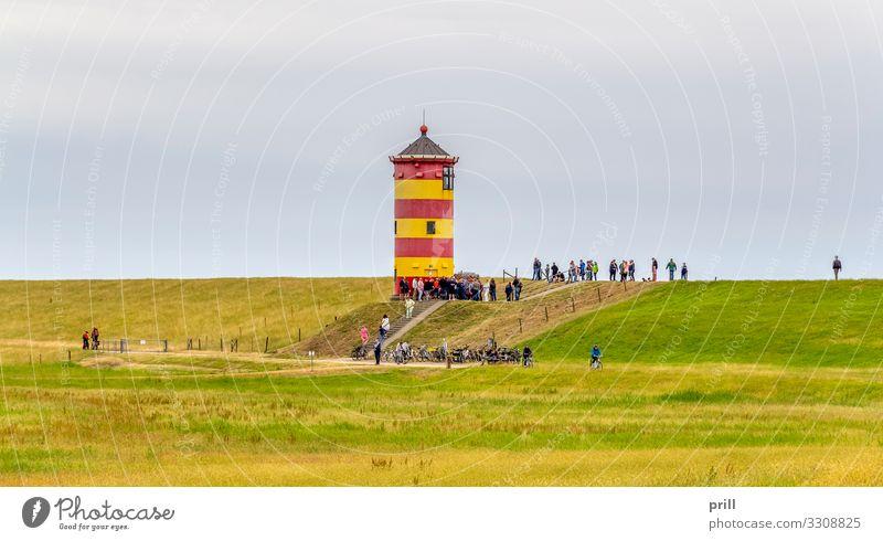 Pilsum Lighthouse Tourismus Gras Wiese Küste Turm Leuchtturm Wahrzeichen gelb rot pilsumer leuchtturm leuchtfeuer Deich Ostfriesland Landkreis Friesland