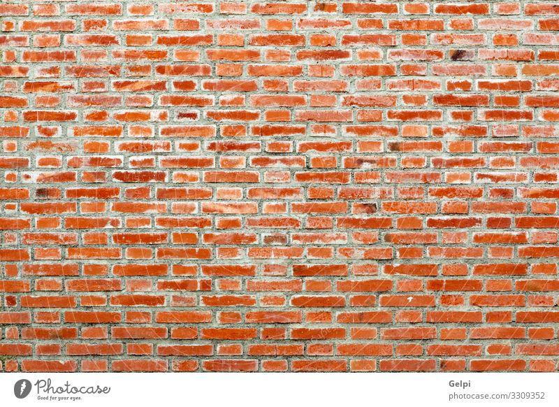 Detail einer roten Ziegelwandtextur Tapete Gebäude Architektur Stein alt retro braun Zement Wand urban Oberfläche sonnig Klotz Material Konsistenz Mauerwerk