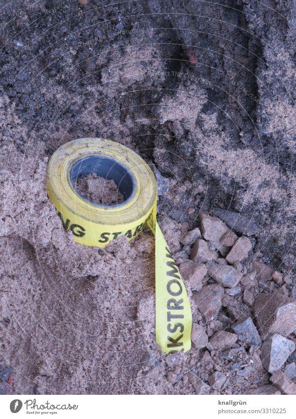 STARKSTROM schwarz gelb Stein braun Sand dreckig Kommunizieren bedrohlich Baustelle Schutz Verantwortung