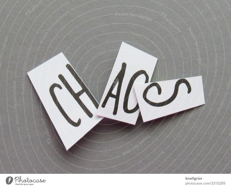CHAOS Schriftzeichen Schilder & Markierungen Kommunizieren grau schwarz weiß Gefühle chaotisch durcheinander Farbfoto Studioaufnahme Menschenleer