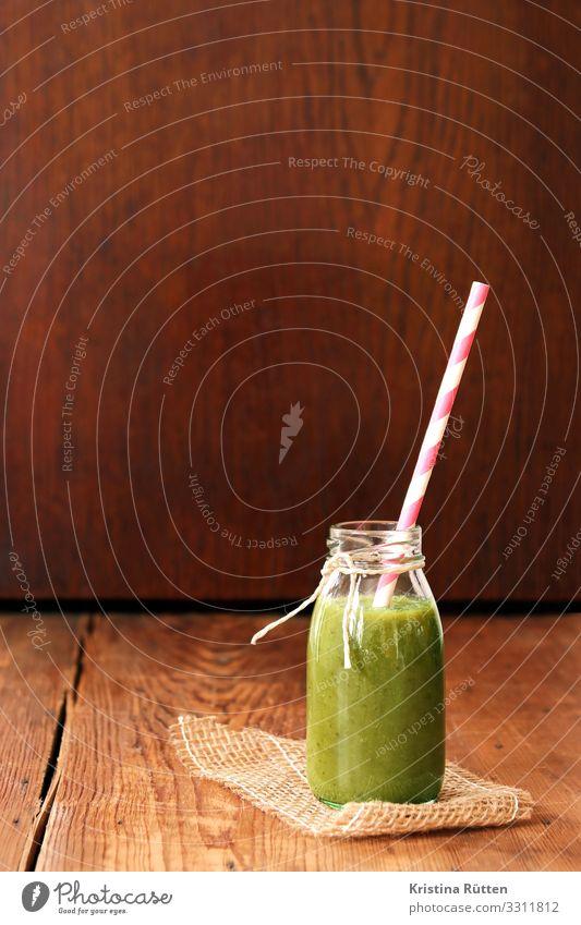 smoothie in grün Gemüse Frucht Ernährung Getränk trinken Saft Flasche Trinkhalm Lifestyle Gesundheit Holz Flüssigkeit frisch lecker Grünkohl Spinat Banane