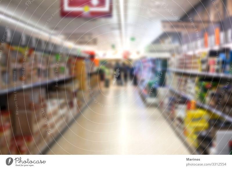 Abstrakter verschwommener Supermarktgang Lebensmittel Lifestyle kaufen Business verkaufen frisch Lager Hintergrund Markt Gang Innenbereich Einzelhandel