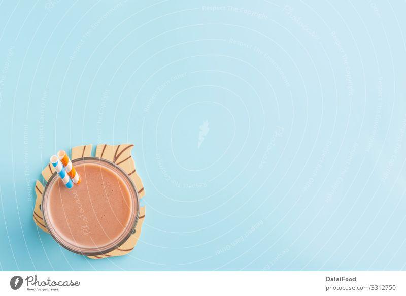 Schoko-Milchshake im farbigen Hintergrund Dessert Ernährung Frühstück Getränk Kakao Sommer Tisch Holz frisch lecker braun weiß Energie gemischt Schokolade