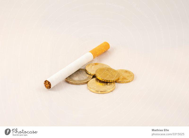 Zigarette mit Euro Geldmünzen Gesundheit Krankheit Rauchen Cent Metall Ziffern & Zahlen Eurozeichen gold orange silber weiß Kapitalwirtschaft sparsam Tabak