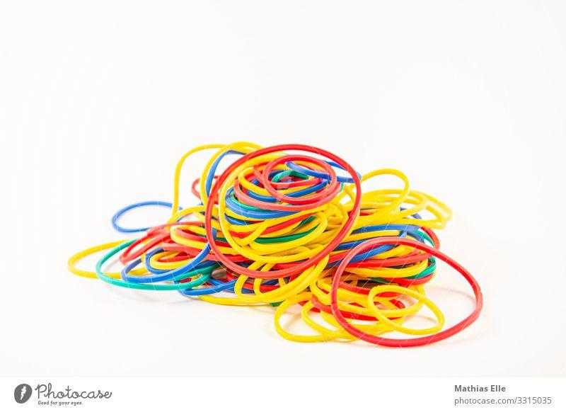 Bunter Haufen Gummibänder blau rot gelb Business Büro Ordnung chaotisch Gummiband