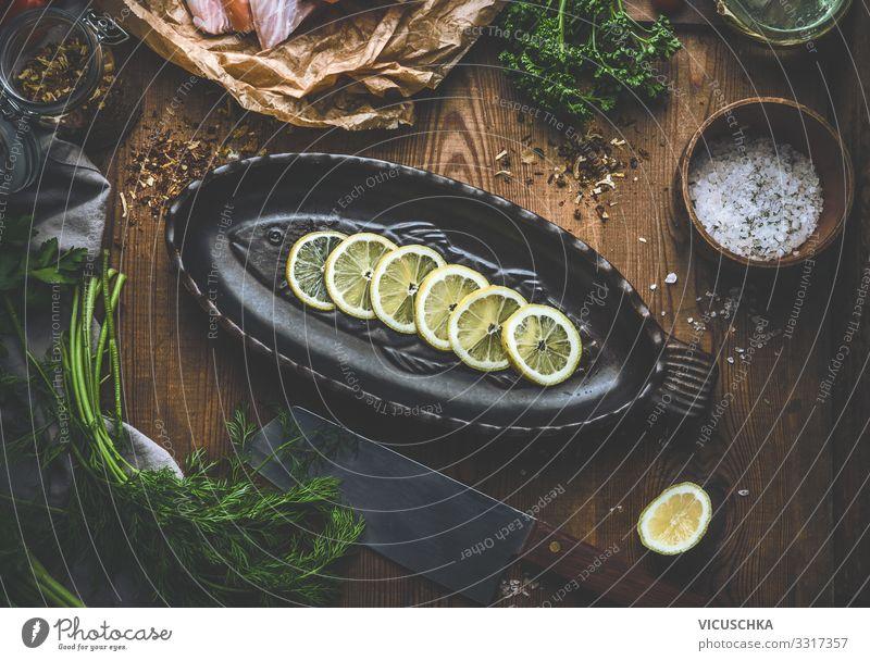 Fisch Backpfanne mit Zitronenscheiben Lebensmittel Bioprodukte Diät Geschirr Stil Gesunde Ernährung Häusliches Leben Küche Restaurant Design fish cooking