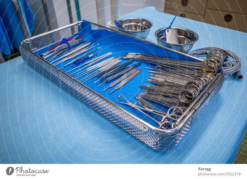 sieve for hand surgery on a blue sheet Krankenhaus Mensch Frau Erwachsene Hand Sauberkeit blau silber medicine instrument medical doctor Gerät clinic health