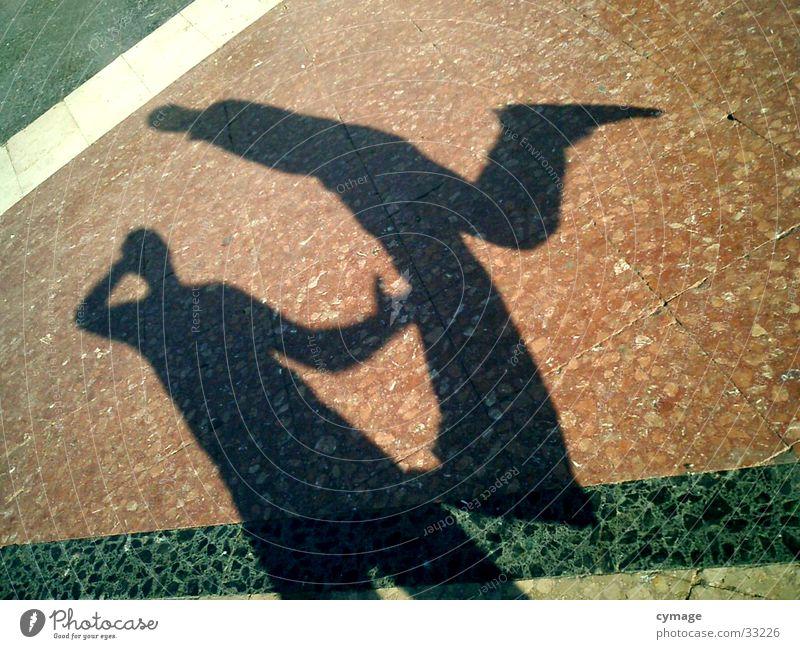 schatten-01 Barcelona springen Mann 2 hüpfen Silhouette rot Platz Selbstportrait Kick Schatten Bodenbelag außergewöhnlich