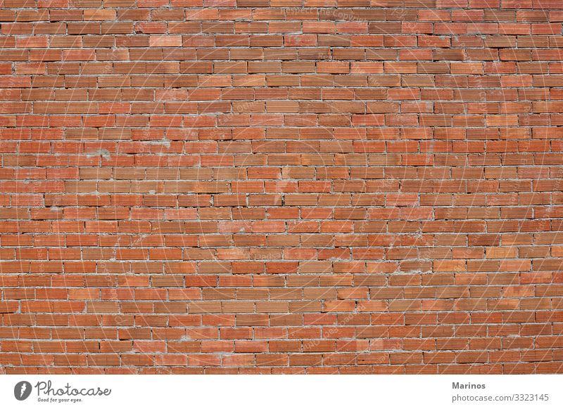 Backsteinmauer als Hintergrund. Tapete Gebäude Architektur Beton alt rot Baustein Wand Konsistenz orange Maurerhandwerk solide Konstruktion Oberfläche Zement