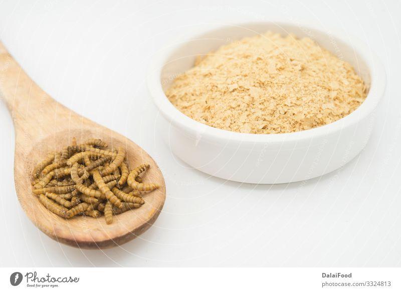 Wurmmehl auf weißem Hintergrund Diät essbar Mehl braten Insekt vereinzelt Larve Protein weißer Hintergrund Farbfoto