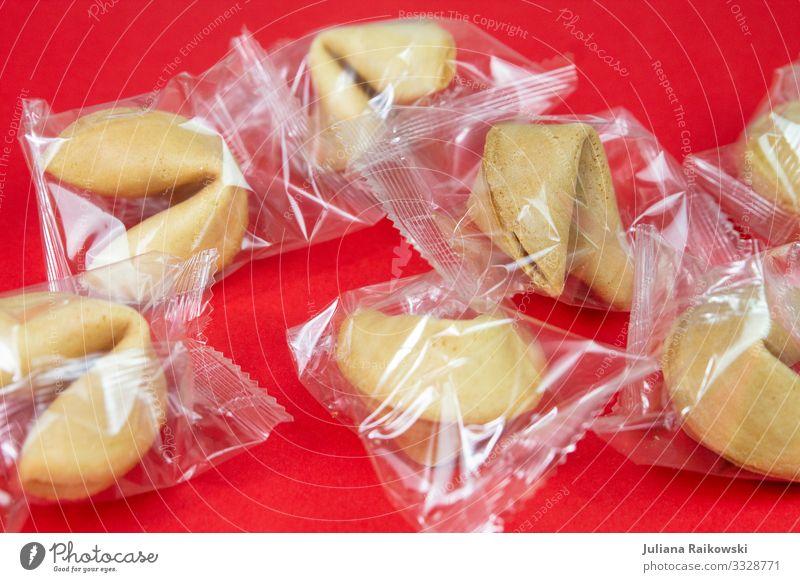 eingepacktes Glück Kultur China Chinesisch Asien Glückskeks Essen exotisch Kitsch süß rot Glaube Religion & Glaube Plastiktüte Kunststoff Müll Zukunft