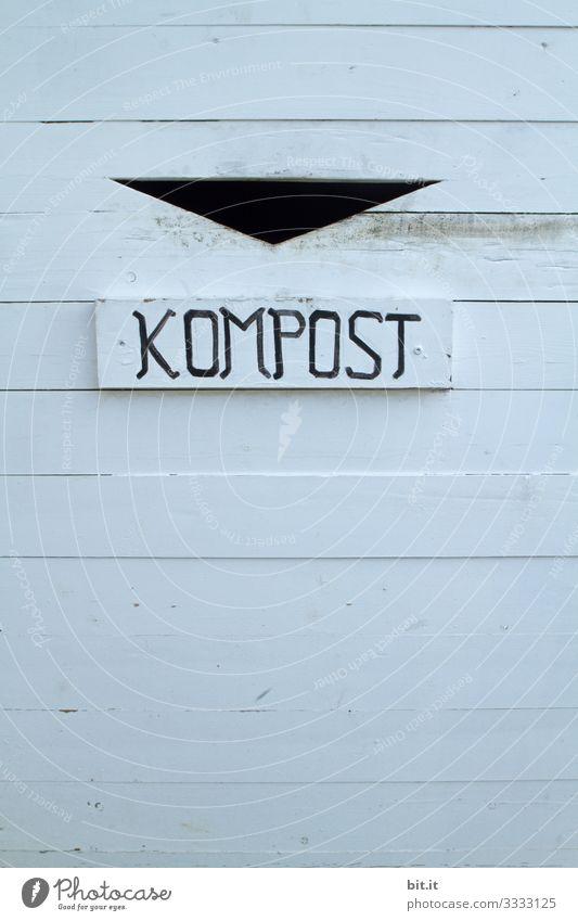 Schriftzug Kompost, auf einem Schild eines Abfallbehälters zur Mülltrennung zum Umweltschutz und Klimawandel. Kompostierung Klimaschutz nachhaltig