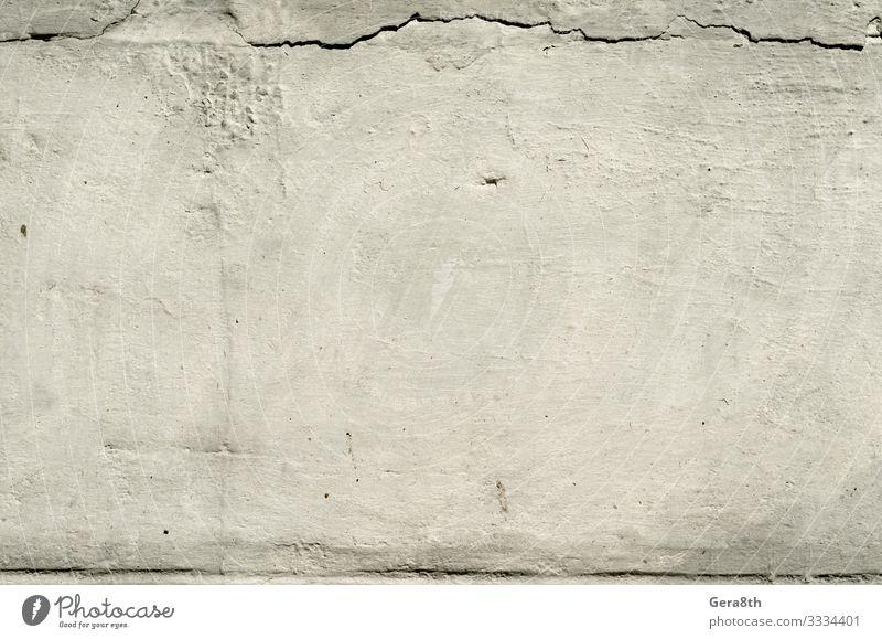 Textur alte Betonwand mit Putzresten mit Rissen Design Dekoration & Verzierung Tapete Architektur Stein dunkel grau schwarz weiß Hintergrund alte Betonmauer