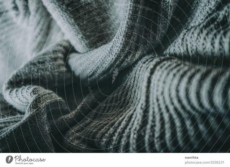 Detail der warmen Wollkleidung Wolle Wollstoff Textur Textil weich Winter Oberfläche Kontrast winken grau Monochrom Kleidung Bekleidung Mode Tapete abstrakt