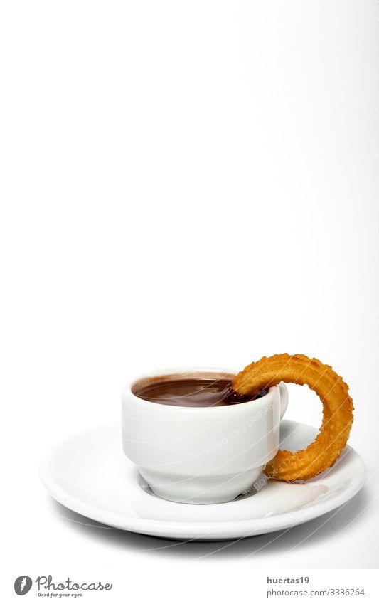 Tasse Schokoladensauce mit Churros Lebensmittel Dessert Frühstück Getränk Kakao Kultur heiß braun weiß Tradition Spanisch Hintergrund Backwaren braten Snack