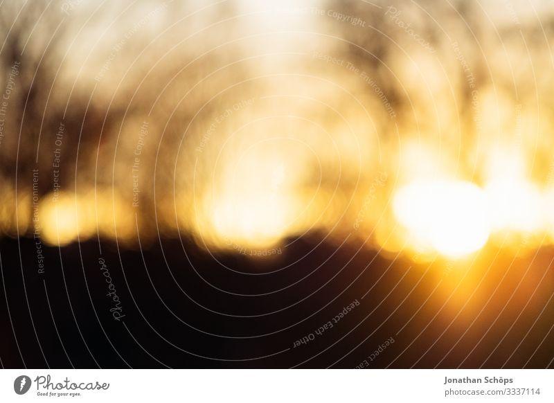 Sonnenuntergang Bokeh Hintergrundbild mit Bäumen bokeh lichter Baum Sonnenuntergangshimmel Sonnenuntergangsstimmung Sonnenuntergangslandschaft