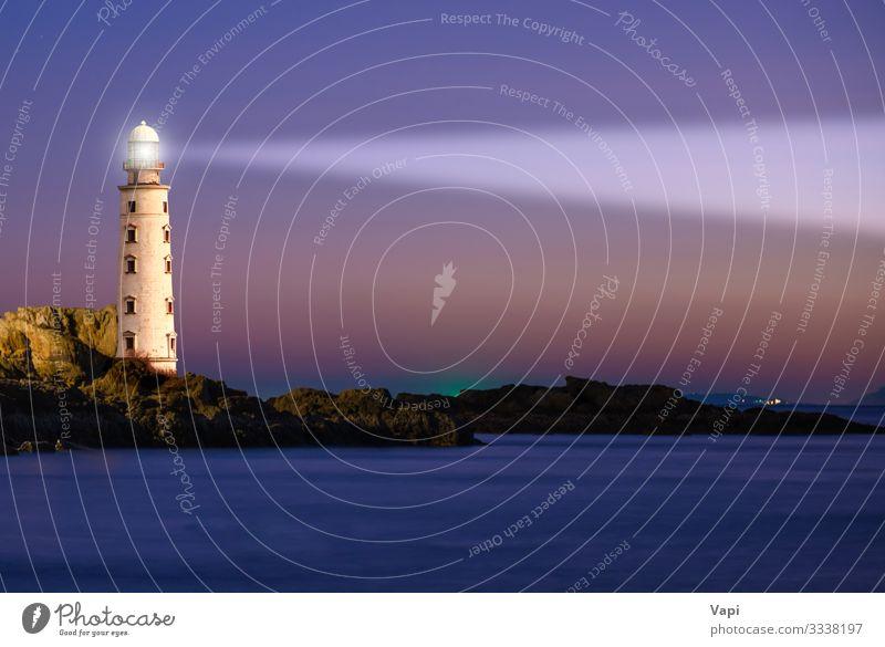Leuchtturm im Sonnenuntergang am Meer Ferien & Urlaub & Reisen Ferne Freiheit Sommer Strand Insel Wellen Haus Lampe Industrie Natur Landschaft Luft Wasser