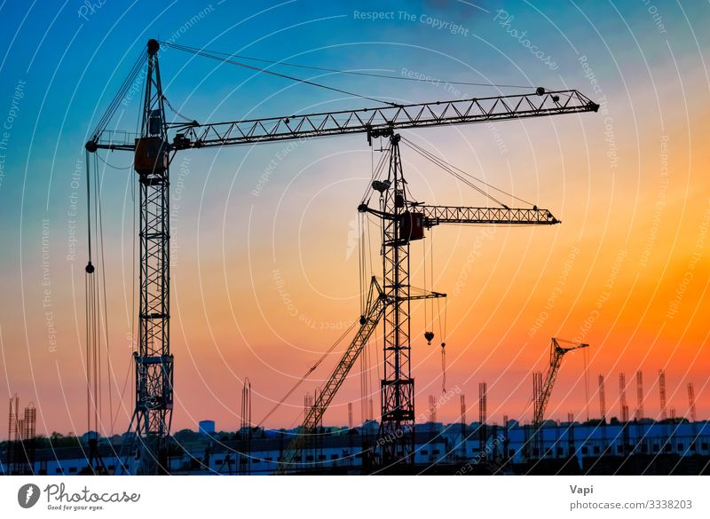 Industriekräne Sonne Arbeit & Erwerbstätigkeit Arbeitsplatz Baustelle Business Unternehmen Werkzeug Maschine Baumaschine Technik & Technologie Landschaft Himmel