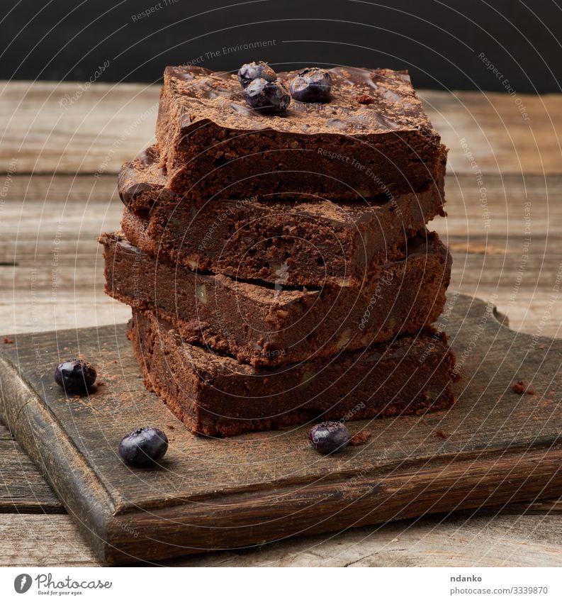 gebackene Scheiben Brownie-Schokoladenkuchen Kuchen Dessert Ernährung Essen Kakao Tisch Holz dunkel frisch lecker braun schwarz Tradition Bäckerei Biskuit