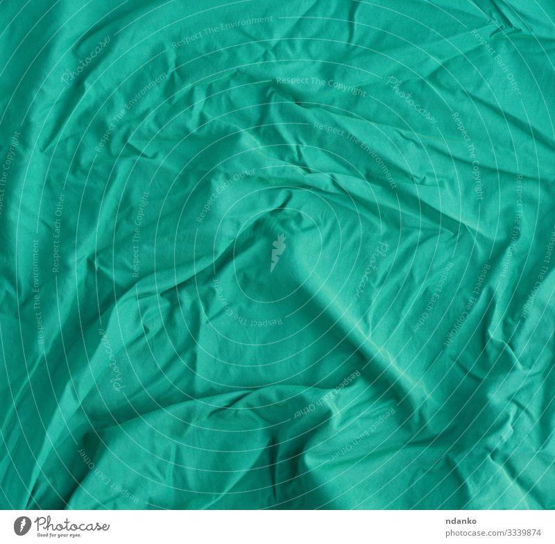 geknitterter hellgrüner Baumwollstoff Design Stoff modern natürlich Sauberkeit weich Leinwand Baumwolle Hintergrund blanko Deckung gefaltet zerknittert Einfluss