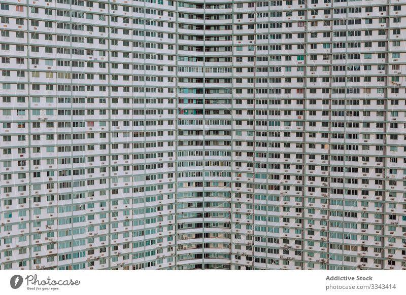 Gebäudefassade mit vielen Fenstern Fassade Hintergrund Textur Außenseite Architektur Struktur Büro Zentrum Haus wohnbedingt Großstadt Straße modern urban