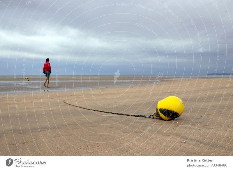 trudging slowly over wet sand Strand Meer Mensch feminin Junge Frau Jugendliche 1 Natur Landschaft Sand Wolken Horizont Klima Wetter schlechtes Wetter Küste